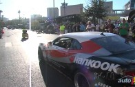 Parade of custom cars and trucks leaving the 2010 SEMA Show