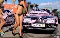 Girls in bikinis washing cars