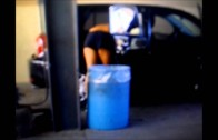 Random shirtless sexy guy at a car wash washing his car