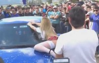 Girl dancing and playing with the audience during the car wash Auto Show